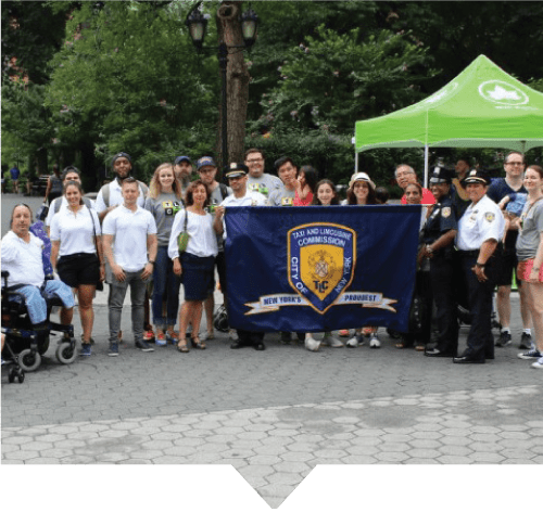 The Accessible Dispatch and TLC outreach teams pose for a photo at the NYC Pride parade, where the teams spread the word about accessible taxi service in New York City.