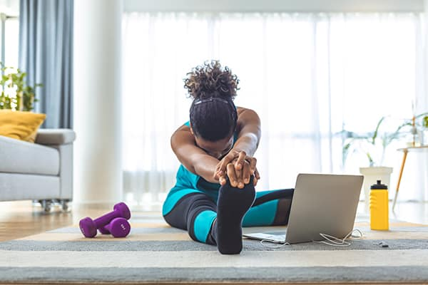 A woman practices yoga. Health and wellness are important benefits of MTM Transit careers and MTM Transit jobs, including our driver jobs.