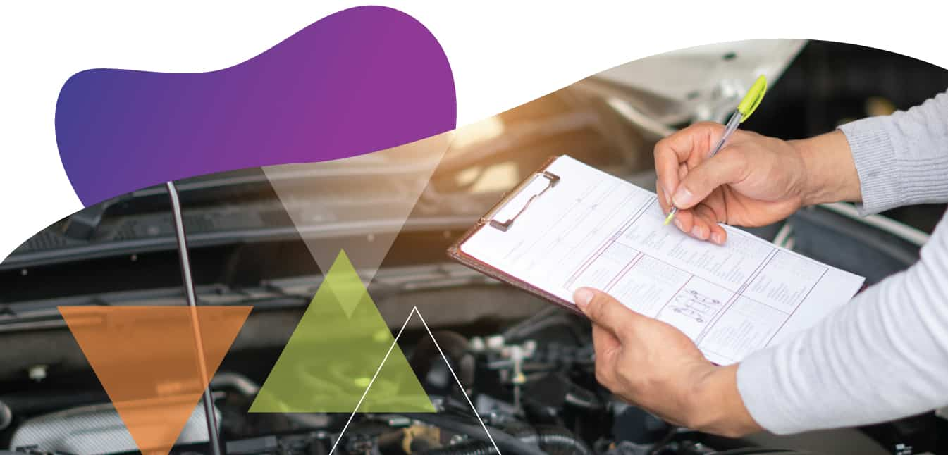 A transit quality assurance contractor uses transit quality control measures to help transit agencies enhance service quality. In this photo, hands hold a clipboard as someone completes a vehicle inspection, which helps ensure vehicle quality assurance.