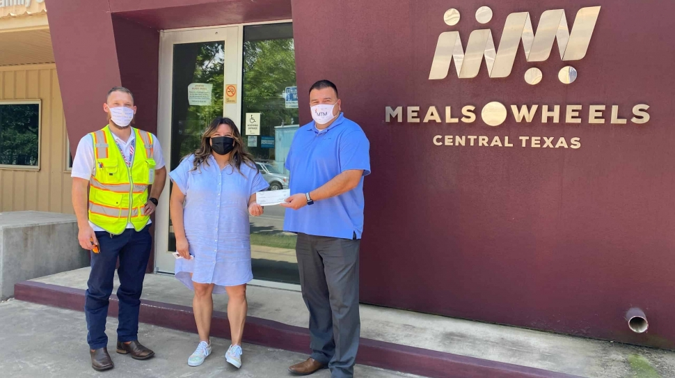 MTM Transit staff present a $500 donation to Meals on Wheels of Central Texas.